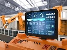 Schermo di computer con fabbrica sullo sfondo